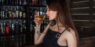 woman drinking at bar