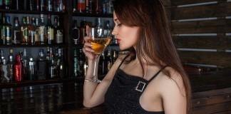 woman drinking at bar