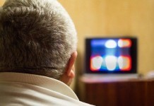 Man watching TV serial