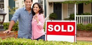 young couple purchase home
