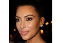 Kim Kardashian under fire for topless photo taken by daughter