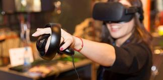 A woman using VR gaming equipment