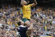 Waratahs player Folau jumping in rugby game