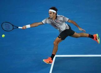 Federer playing tennis