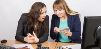 Women comparing tech accessories