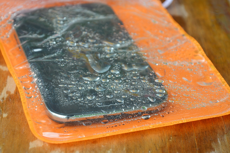 orange waterproof phone bag on wooden board