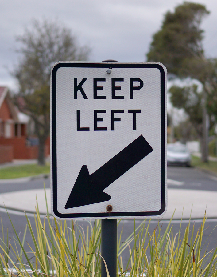 Keep left traffic sign in white and black color