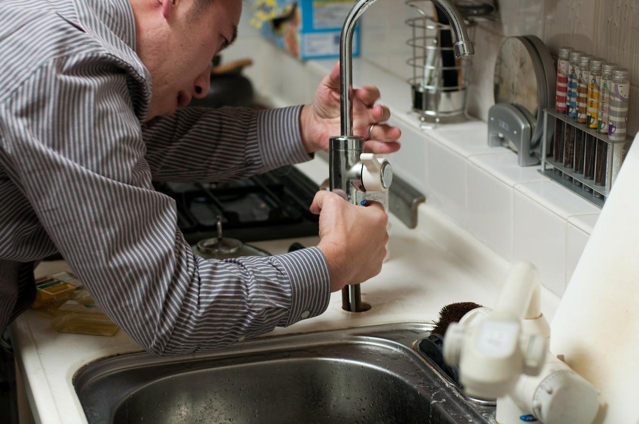 Handyman fixing tap fixture