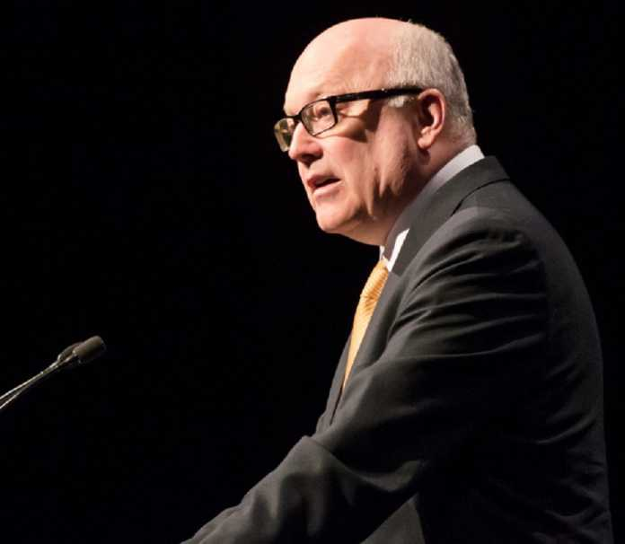 George Brandis predicts Nauru children will be resettled by end of year