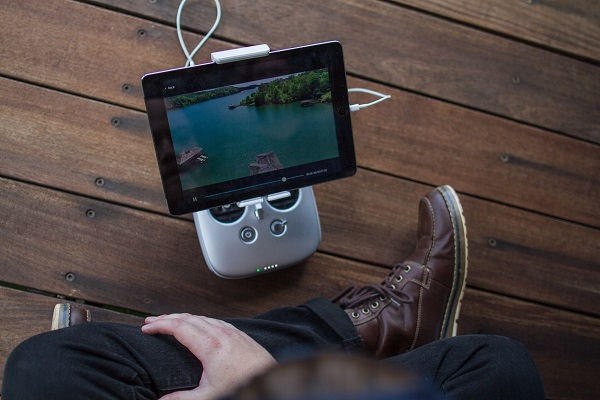 Man streaming content via a tablet