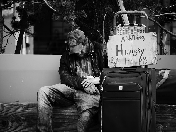 Homeless man with belongings