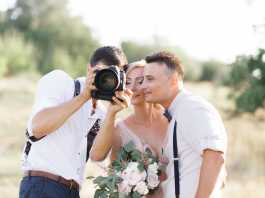 How do photographers prepare for a wedding shoot