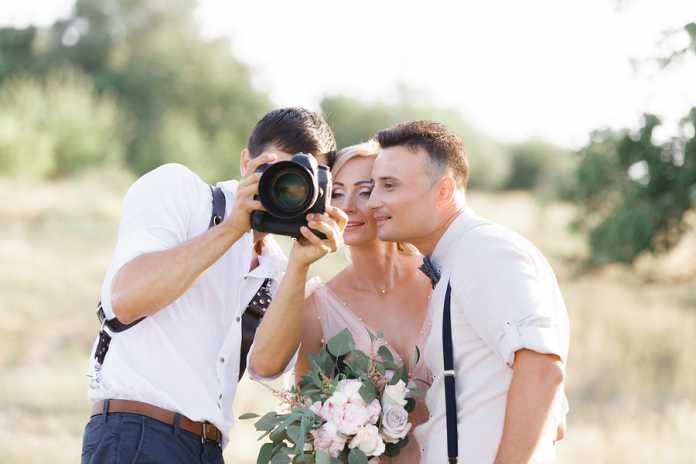 How do photographers prepare for a wedding shoot