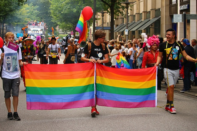 People holding gay pride banner