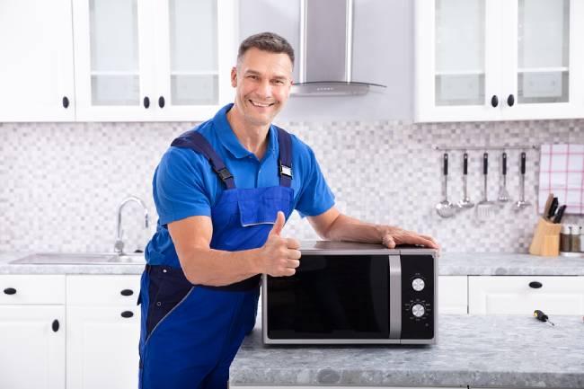 Man Repairing Microwave Oven