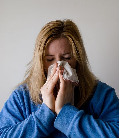 Woman with nasal allergy