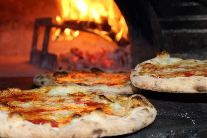 Freshly baked pizzas inside a pizzeria