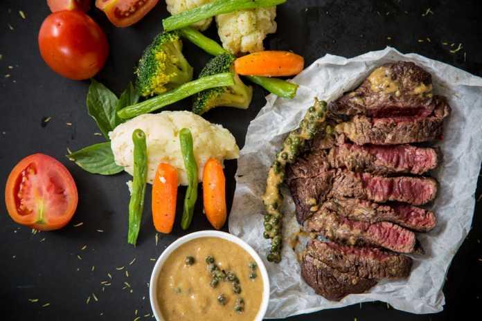 Tasty steak with veggies.