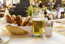 Classic German dinner of fried sausages with light beer.