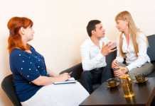 Young married couple consulting a marriage counsellor.