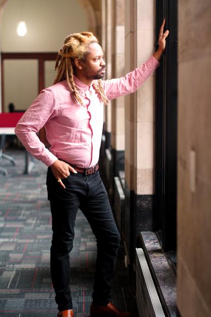 man pink shirt office