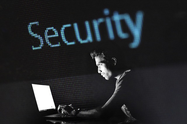 Cyber security guide for small businesses typing code