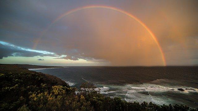 adventuring Australia rainbow over coastal waters