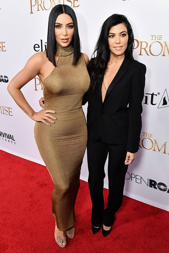 Kim arriving at the premiere of 'The Promise' with sister Kourtney