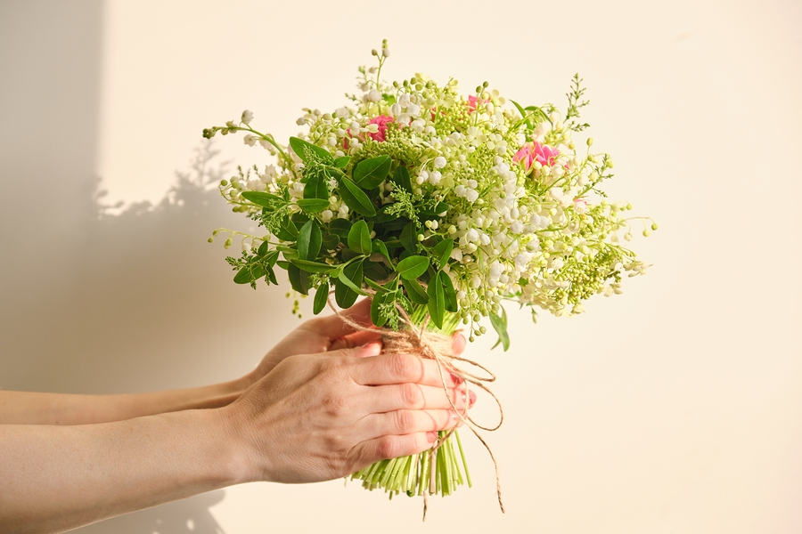 Beautiful fresh bouquet of lily of the valley flowers