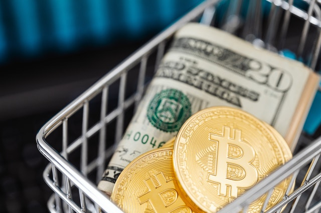Money and digital currency in a shopping cart as they are the future just like the Internet was at birth.