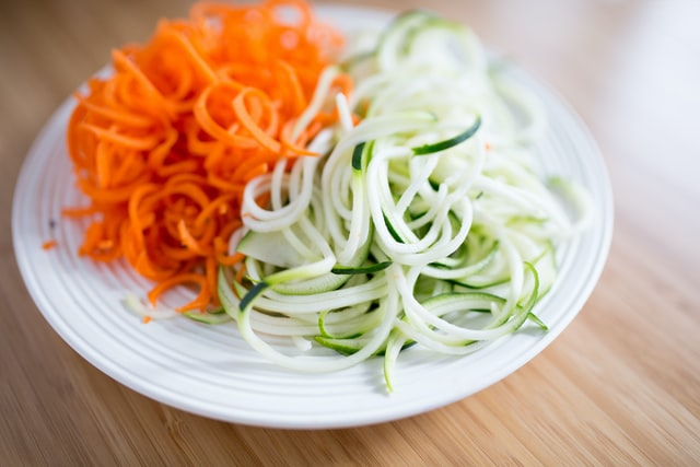 A plate of carrots and zoodles as a keto-friendly meal.