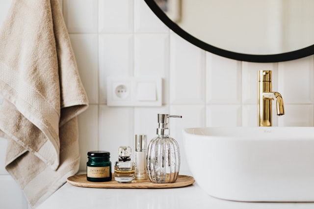 A bathroom with cosmetic products from a best wholesaler on the bench.