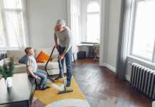 A father and son DIY vacuuming carpet cleaning.