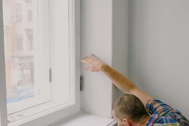 A man in Sydney installing double glazed windows in a home.