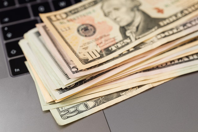 Cash on a laptop from a fast and secure online service.
