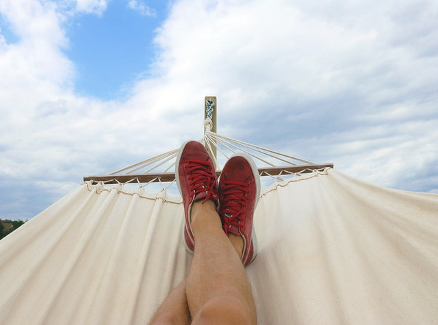 Feet on a hammock after planning a summer vacation