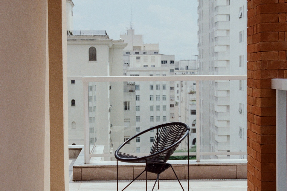 A chair on the balcony of a Sydney residential property development.