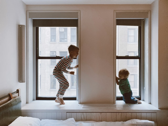 Two kids playing in the windows of the Sydney property developments with features that they wanted.