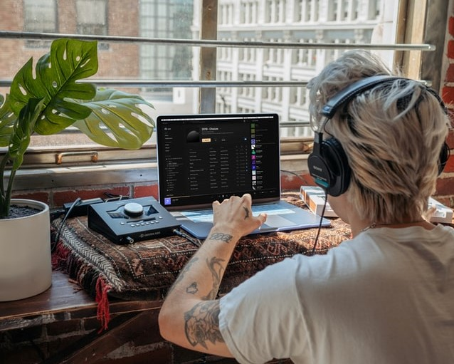 A person using their home studio setup and audio interface to create a chart topping hit.