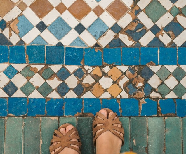 Feet walking on better tiles and ceramics for a home.