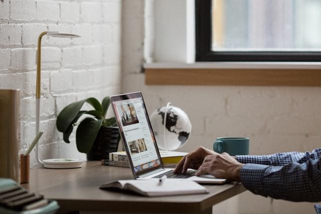 Man using laptop to build website using free website builder.