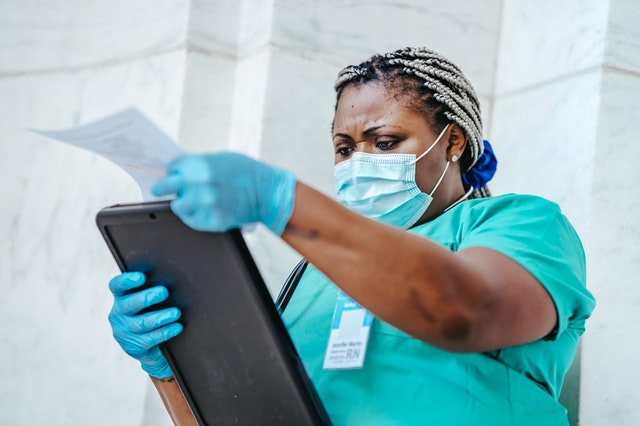 A breast surgeon in Berwick looking through her notes on a patient.