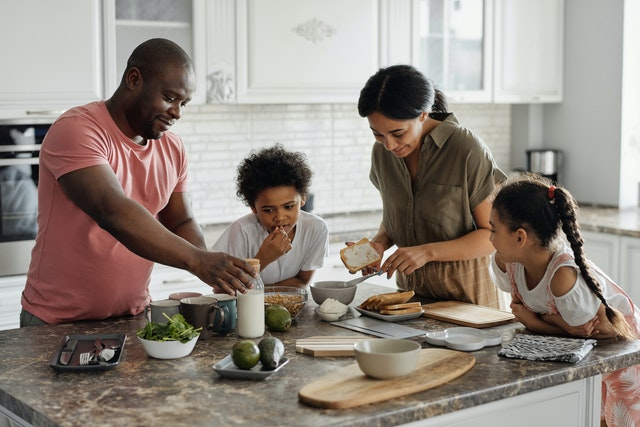 A family cooking a meal they found on an internet food blog.
