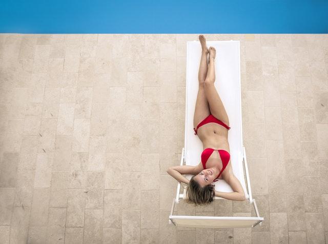 High waisted thong bikini on a lady next to a pool