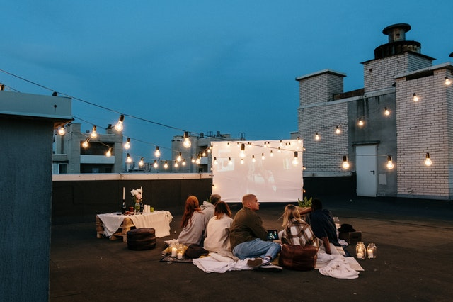 People at an outdoor cinema as a home entertainment area.