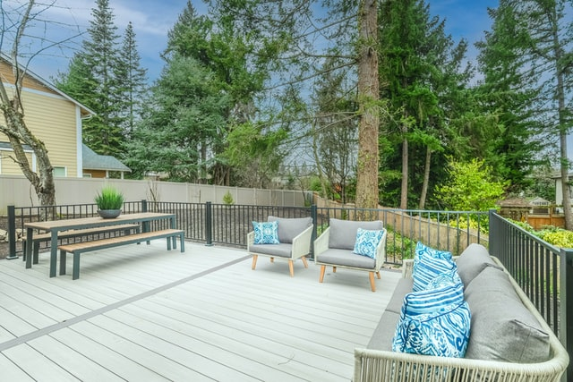A home with benefits such as wooden decking and shrubs.