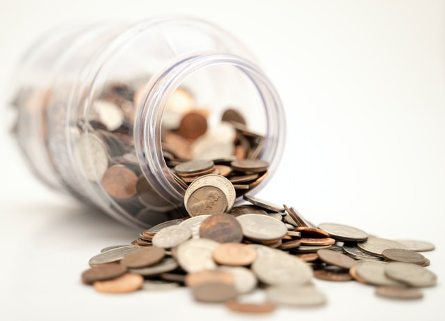 A coin jar of profits from a micro investment.