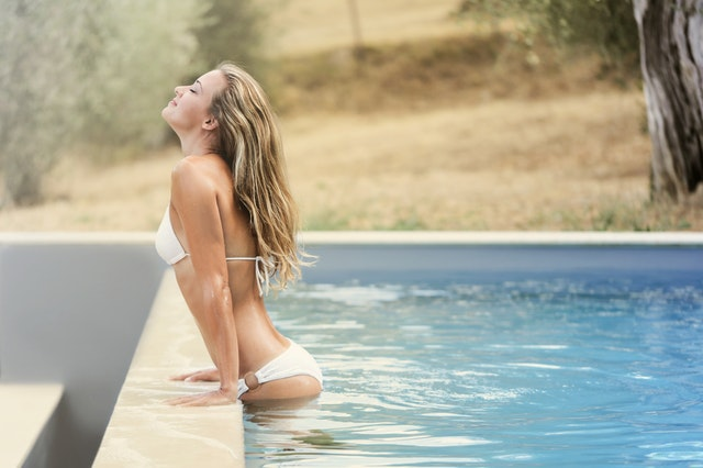Myra Swim product lines on a woman in a pool.