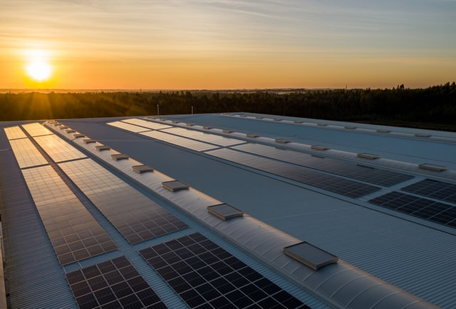 Solar panel structure at sunset for renewable energy in Australia.