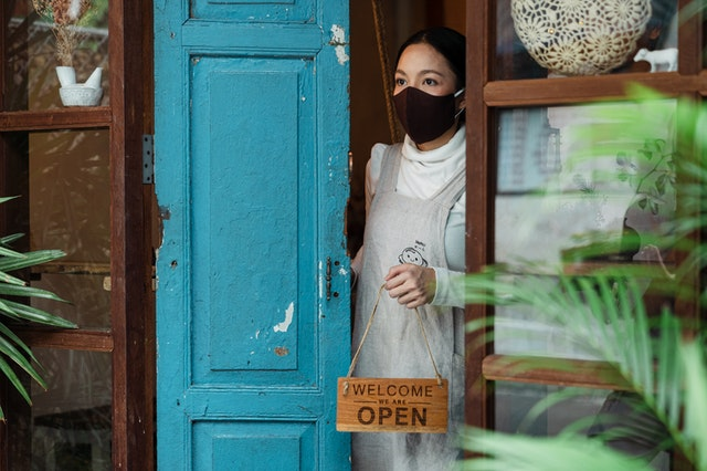 A woman opening her small retail business in Australia during the effects of second order covid.
